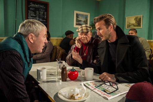 David Beckham (right) as he joins Sir David Jason (centre) and Nicholas Lyndhurst, as a guest in a special Only Fools And Horses sketch reuniting Del Boy and Rodney for the first time in a decade, to be screened as part of BBC1's Sport Relief night in March. Photo credit: Comic Relief/PA Wire
