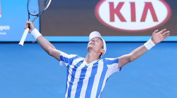 Tomas Berdych of the Czech Republic celebrates winning his quarterfinal match against David Ferrer of Spain during day nine of the 2014 Australian Open at Melbourne Park.