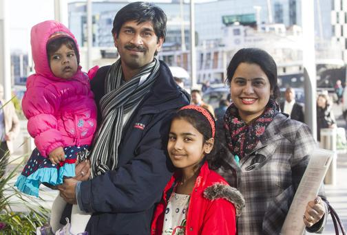 Devendra and Nutan Adurkar with their children Tanisha (1) and Saloni (9) from India and now Clonmel at the Citizenship ceremony held in the Dublin Convention Centre. Picture: Mark Condren