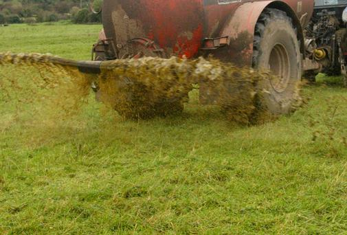 Tractor spreading slurry