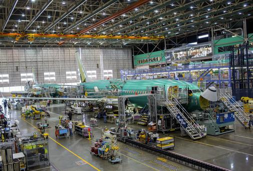 Workers assemble a Boeing 737 airplane on line 2 at the company's factory in Renton, Washington