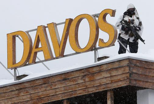 A Swiss policeman patrols before the start of the annual meeting of the World Economic Forum in Davos
