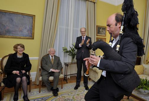 President Higgins and wife Sabina watch Galician musician Carlos Nunez at the Spanish Ambassador's residence.