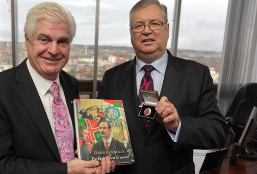 Joe Duffy receives a union badge from SIPTU General Secretary Joe O'Flynn