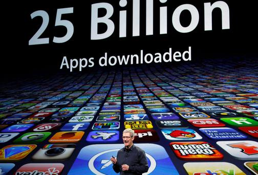 Apple CEO Tim Cook speaks about the number of Apps downloaded during an Apple event in San Francisco