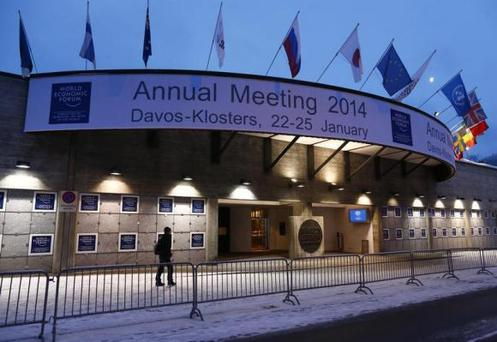 A person walks past the entrance of the congress centre for the annual meeting of the World Economic Forum (WEF) 2014 in the early morning in Davos January 21, 2014. REUTERS/Ruben Sprich