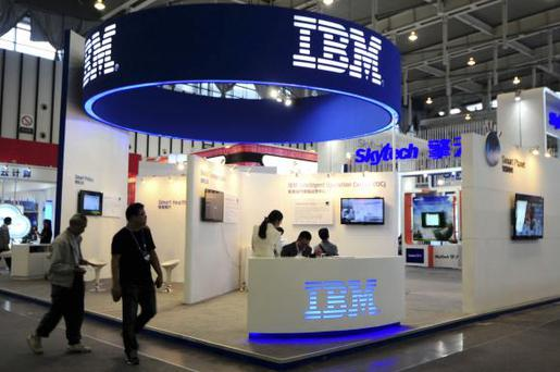 Visitors walk past the IBM booth at the 9th China International Software Product & Information Service Expo in Nanjing, Jiangsu province