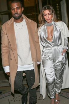 Kanye West and Kim Kardashian leave the 'Meurice' hotel on January 21, 2014 in Paris, France. (Photo by Marc Piasecki/FilmMagic)