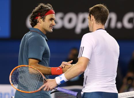 Andy Murray shakes hands with Roger Federer after Federer won their quarterfinal match during day 10 of the 2014 Australian Open at Melbourne Park.