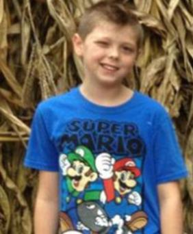 Tyler Doohan (8) has lost his life in a fire after he saved the lives of six other people. (Facebook)