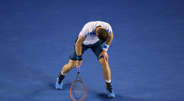 Andy Murray reacts to a point in his quarterfinal match against Roger Federer at the Australian Open