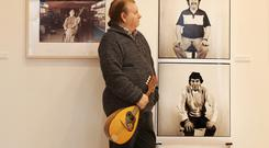 Eddie Furey of the Fureys looks at a photo taken of his brothers by photographer Jim Maginn. Photo: Leon Farrell/Photocall Ireland.