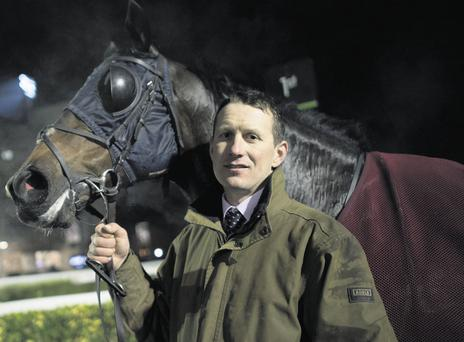 Trainer Johnny Butler and Low Key after the winning race at Kempton