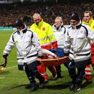 Monaco's Columbian forward Radamel Falcao (C) is lifted away from the pitch after being injured during the French Cup football match between Chasselay and Monaco back in January