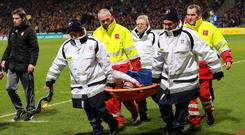 Monaco's Columbian forward Radamel Falcao (C) is lifted away from the pitch after being injured during the French Cup football match between Chasselay and Monaco.