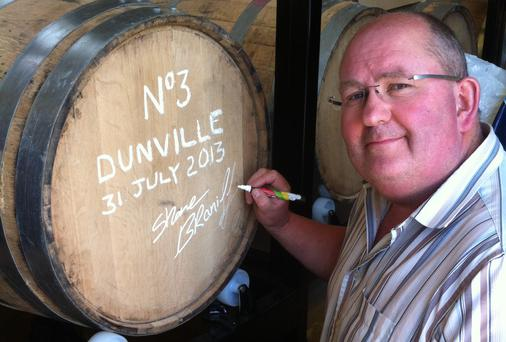 Businessman Shane Braniff with his Dunville whiskey