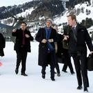 US Secretary of State John Kerry (C) arrives in Davos