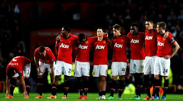 Dejected Manchester United players watch on as they slump to a penalty shootout defeat to Sunderland in the capital One Cup semi-final