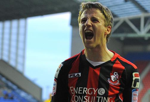 Bournemouth's Irish midfielder Eunan O'Kane celebrates after scoring for Bournemouth against Wigan Athletic in the FA Cup