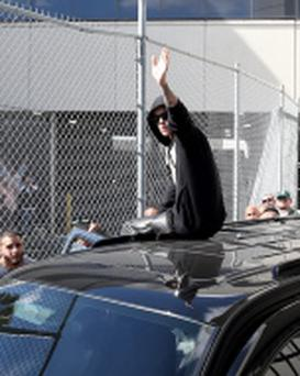 Justin Bieber waves after exiting from the Turner Guilford Knight Correctional Center on January 23, 2014 in Miami, Florida.