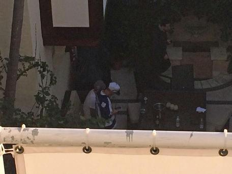 Justin Bieber (seen here at the bottom of the photo) spotted out drinking with his dad following his release from jail. (Twitter/Gaby Fleischman)