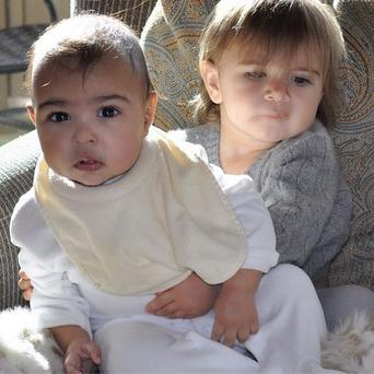 Meanwhile, the proud mum has shared this photo of Scott and Kourtney's daughter Penelope holding his cousin North for a snap Photo: Instagram/Kim Kardashian