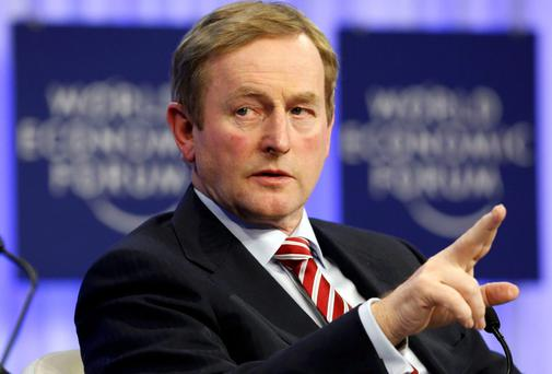 Enda Kenny gestures during a session in Davos