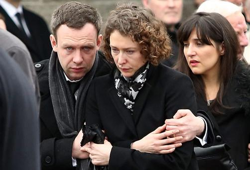 The remains are taken from church followed by Thomas O'Gorman's brother, Paul and sister, Catherine (left and centre).
