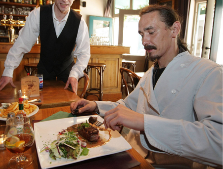 Titus Clarysse eats at a restaurant in Ghent in 2009; Clarysse was known in and around the university town of Ghent for walking into any restaurant for steak to lobsters and walking out without paying