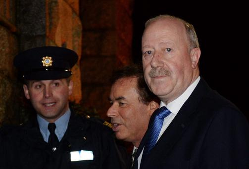 Justice Minister Alan Shatter and Garda Commissioner Martin Callinan going into church for first anniversary memorial service for murdered Detective Garda Adrian Donohoe.