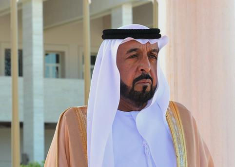 Sheik Khalifa bin Zayed Al Nahyan, president of the United Arab Emirates (UAE), listens to the national anthem during a ceremony with Turkey's President Abdullah Gul in Abu Dhabi, UAE. AP Photo/Murat Cetinmuhurdar, Turkish Presidency Press Office, File)
