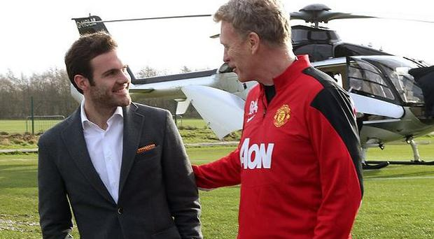 David Moyes greets Juan Mata after he arrived at Carrington today on a helicopter