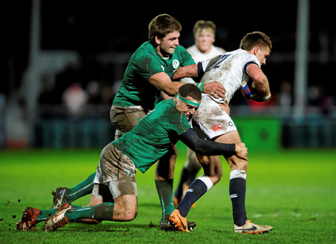 Henry Slade, England Saxons, is tackled by Rob Herring and Iain Henderson