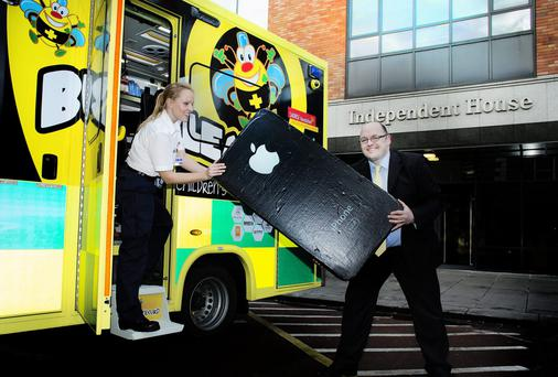 Tony Heffernan with Lucy Holton from the Life line ambulance service at the launch of the Bumblence mobile phone fundraising campaign.