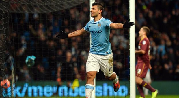 Manchester City's Argentinian striker Sergio Aguero celebrates scoring his third goal during the English FA Cup fourth round football match between Manchester City and Watford