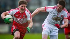 Declan Mullan, Derry, in action against Conor Clarke, Tyrone