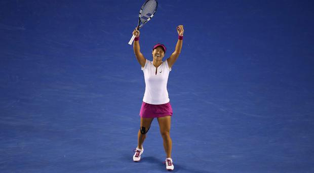 Li Na celebrates her second Grand Slam tournament win after defeating Dominika Cibulková of Slovakia in the final of the Australian Open in Melbourne
