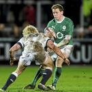 Craig Gilroy, Ireland Wolfhounds, is tackled by Matt Hopper, England Saxons