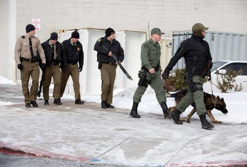 Armed police leave an entrance of the Columbia Mall after a shooting at the mall in Columbia, Maryland.