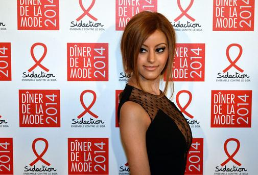 French fashion designer Zahia Dehar poses before taking part in the 'fashion dinner against Aids'