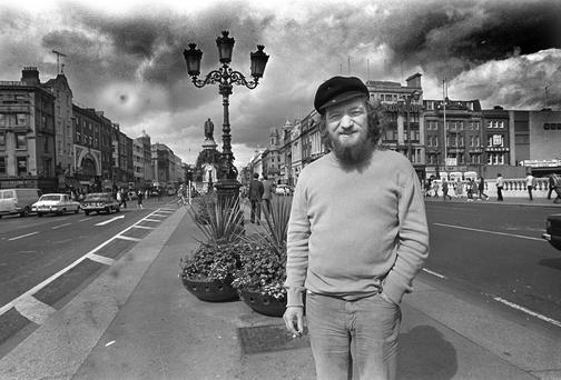 Wild Rover: Luke Kelly on O'Connell Bridge, Dublin, in 1980. Photo: Donal Doherty