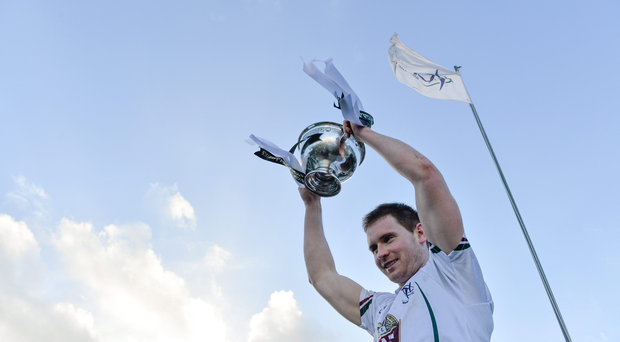 Kildare captain Eoghan O'Flaherty lifts the O'Byrne Cup after the game.