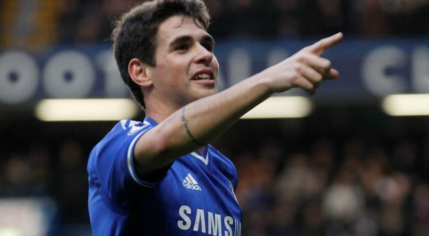 Chelsea's Oscar celebrates his goal against Stoke City during their English FA Cup fourth round