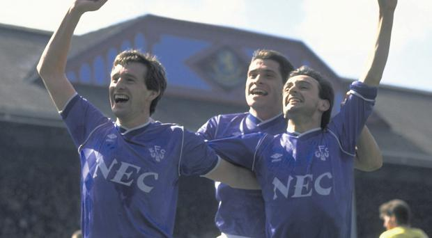 Kevin Sheedy celebrates with Tony Cottee and Pat Nevin during an Everton victory in 1983