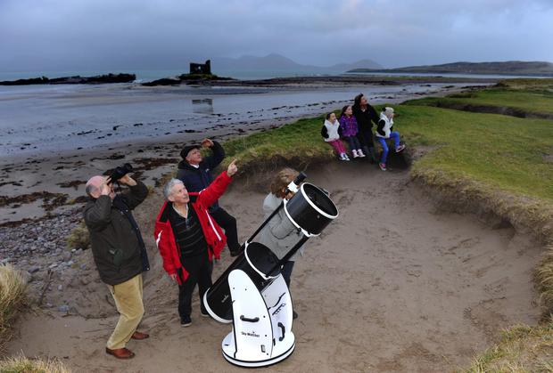Julie Ormonde of the Kerry Dark Sky group pictured on Ballinskelligs Beach observing the sky with local astronomers Michael Sheehan, Dessy Cronin and Michael Lyne at the weekend.