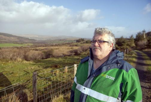 Postman and farmer Dermot Kelleher on his rounds, in Inchegeela, Co. Cork
