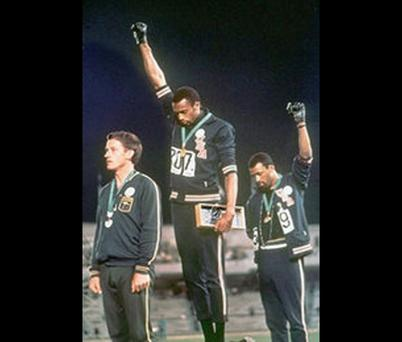 Tommie Smith and John Carlos raise the Black Power salute at the 1968 Mexico Olympics. What if their raised black-gloved fists had been ignored?