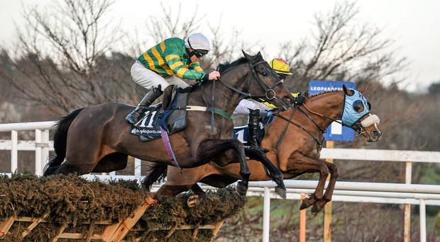Gilgamboa (foreground) ridden by Mark Walsh, eventual winner of the Boylesports.com Hurdle