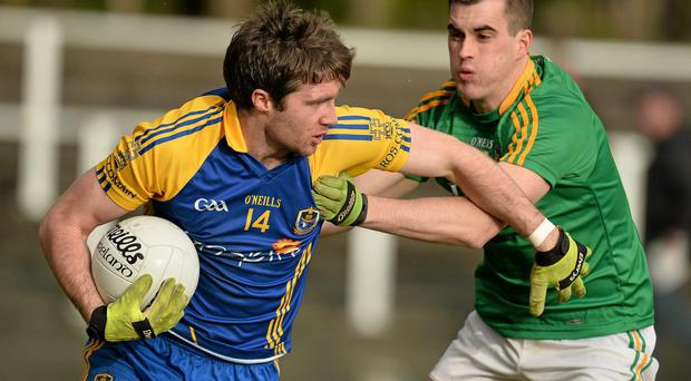 Cathal Cregg, Roscommon, in action against Paddy Maguire, Leitrim