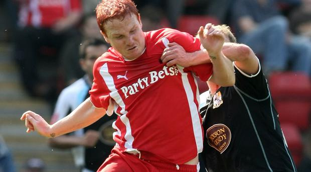 Sean Thornton contests the ball with Luke Guttridge of Northampton Town